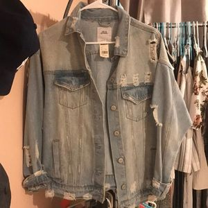 Distressed light washed oversized jean jacket